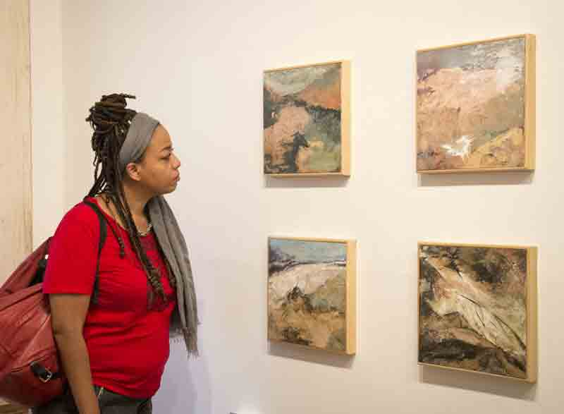 Ana Wright admiring the pieces from the Death Valley Series