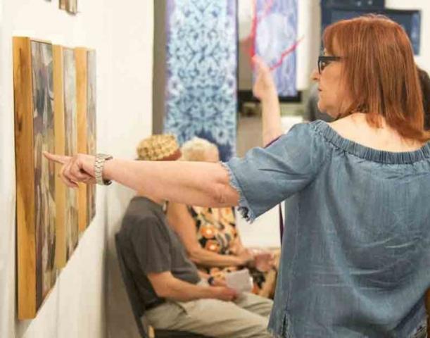 Designer Nancy Sublette pointing out details
